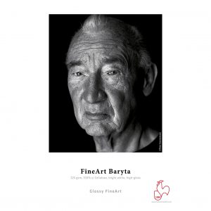 Hahnemühle FineArt Baryta Sample Print. An old man with wrinkled skin against a black background.
