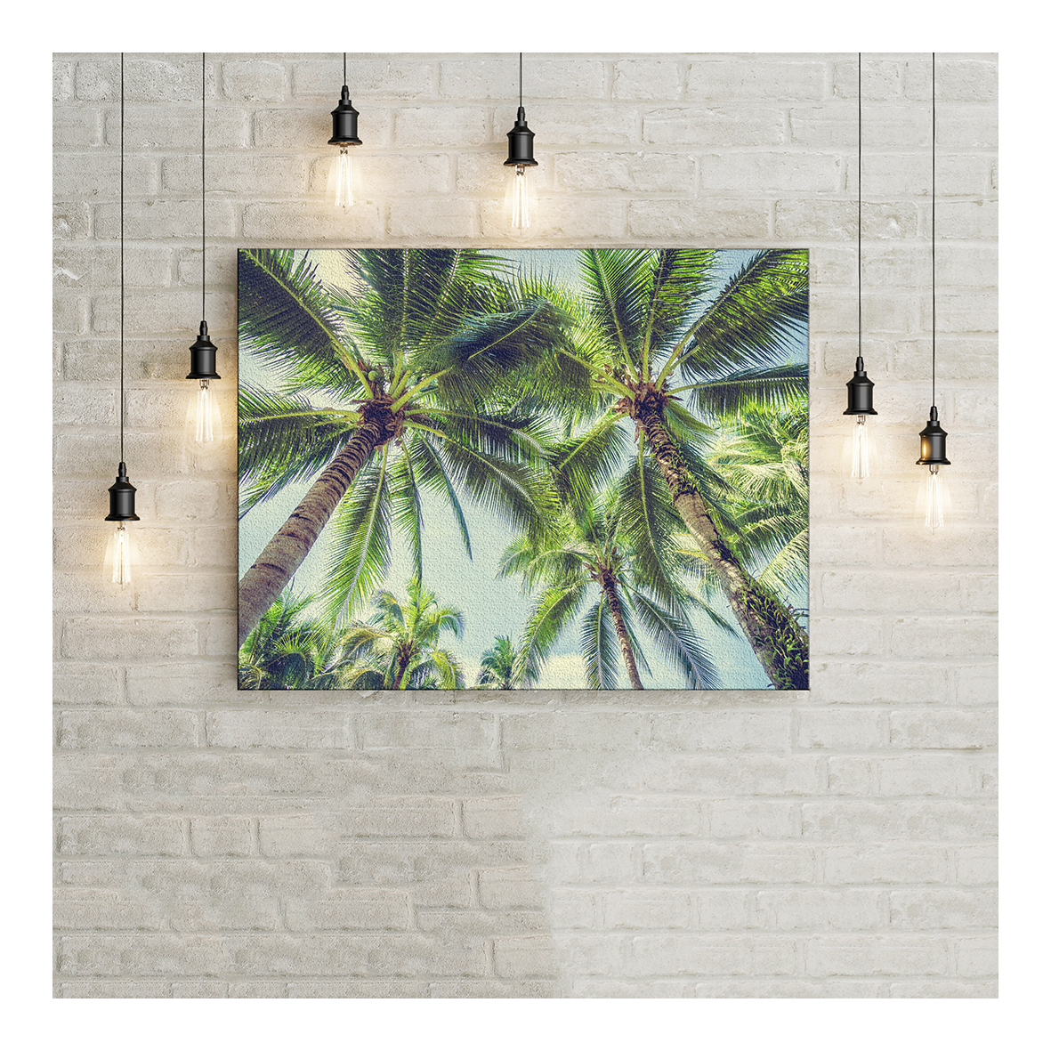 Canvas wrap image on a painted wall with hanging light bulbs.