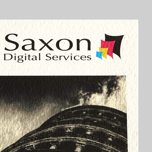 Xpression textured paper with the Saxon Digital Services logo.