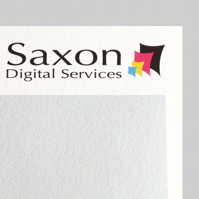 Xpression Smooth paper with the Saxon Digital Services logo.