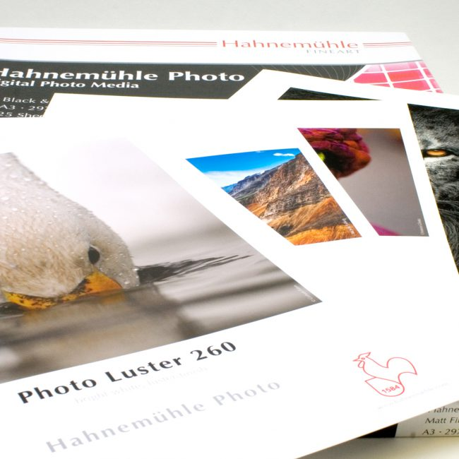 Pile of Hahnemühle Photo Rag® Satin prints.