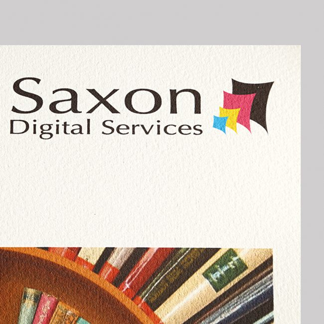 Somerset Velvet textured paper with the Saxon Digital Services logo.