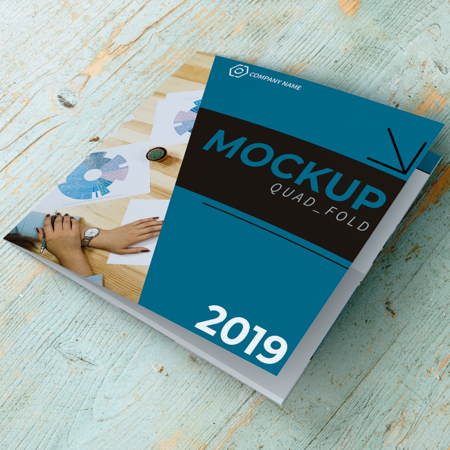A mockup of a quad-fold brochure in a blue and black design.