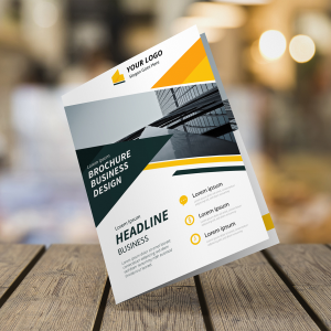 A mockup of a brochure business design. A yellow and black design that you can customise with your own headline and logo.