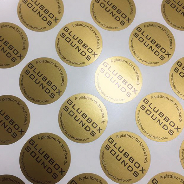 "A page of gold ""Glubbox Sounds"" stickers with gloss surface."