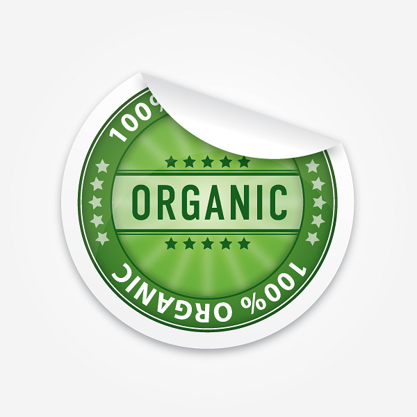"A peeling vinyl sticker in green. Reads ""100% organic"" with organic in large dark green letters."