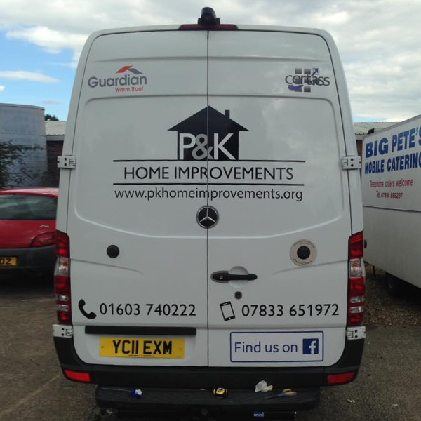 The rear of a van with vinyl decals. It diplays the P&K Home Improvements logo, website address and contact details.